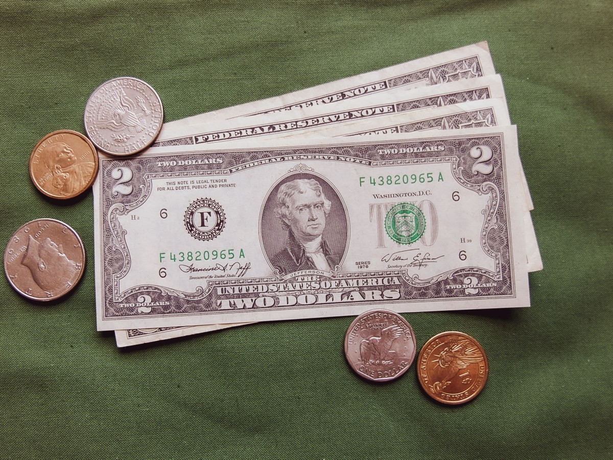 2 dollars bills and coins
