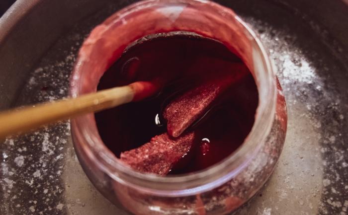 Melting scrap wax to make new candles