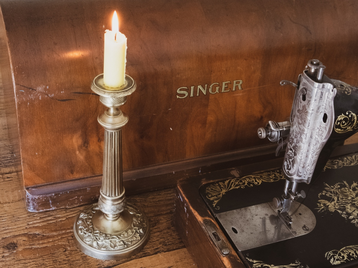 Vintage candlestick and vintage sewing machine